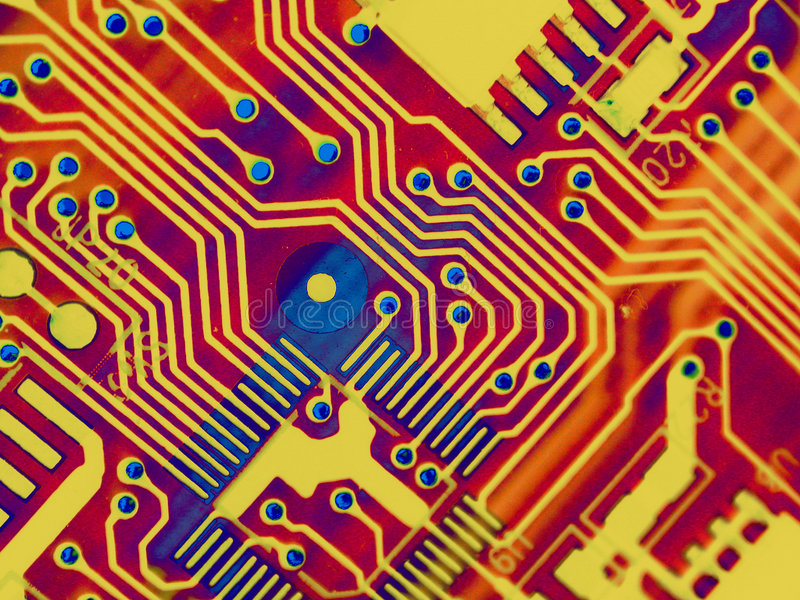 Cool Computer Parts Background. Abstract texture of computer parts circuitboard in glowing red, gold and blue colors ideal as background or pattern royalty free stock photography