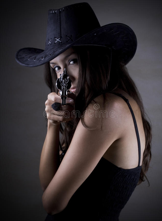 Cool cowgirl with the gun stock images