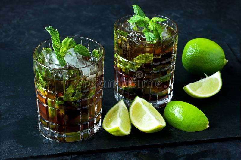 Cool Cuba libre in glasses on dark table, holidays party conc royalty free stock image