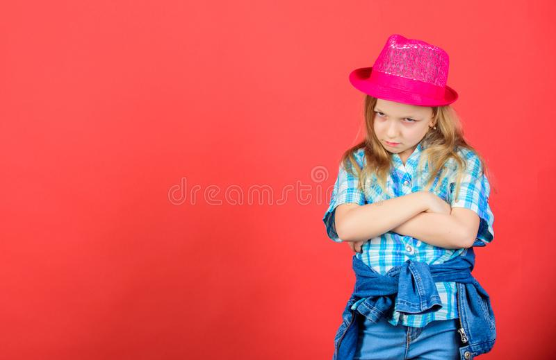 Cool cutie fashionable outfit. Happy childhood. Kids fashion concept. Check out my fashion style. Fashion trend. Feeling. Awesome in this hat. Girl cute kid royalty free stock photography