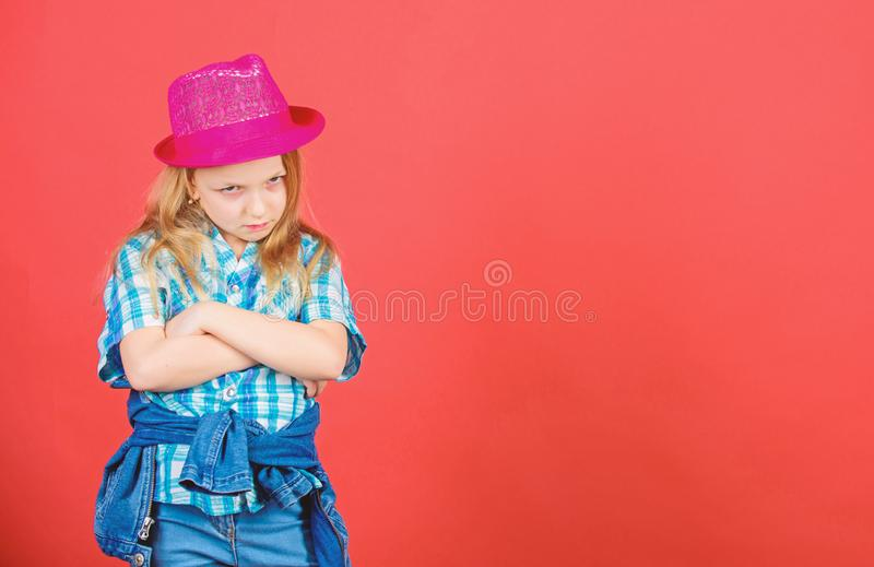 Cool cutie fashionable outfit. Happy childhood. Kids fashion concept. Check out my fashion style. Fashion trend. Feeling. Awesome in this hat. Girl cute kid royalty free stock photo