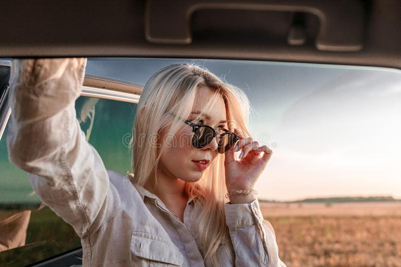 Cool and daring blonde with glasses royalty free stock image