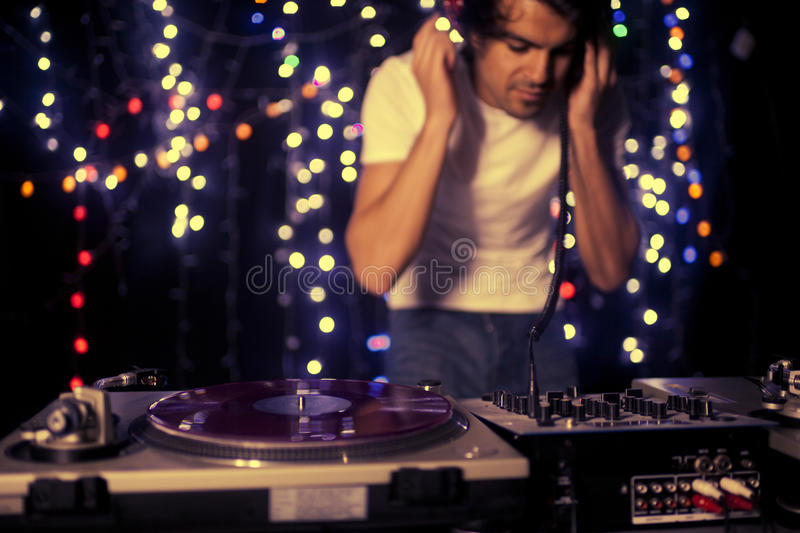 Cool dj. A cool male dj on the turntables royalty free stock images