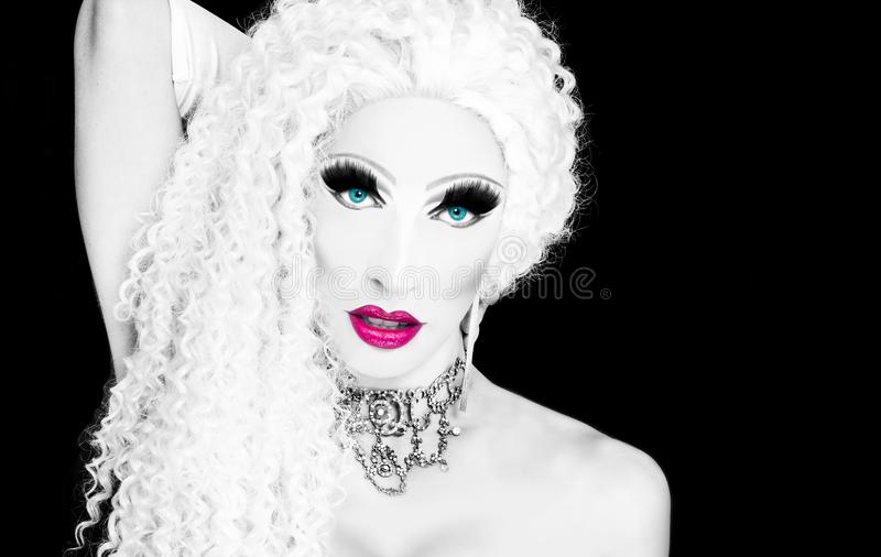Glamorous drag queen. Cool drag queen with spectacular makeup, glamorous stylish look, posing with proud and style for lgtb equality gay rights with rainbow flag royalty free stock photo
