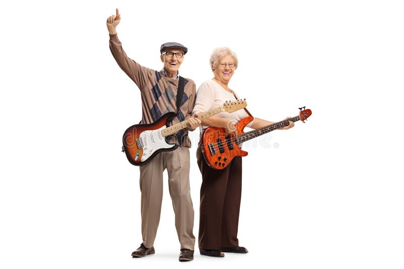 Cool elderly man and woman with electric guitars. Full length portrait of cool elderly men and women with electric guitars isolated on white background stock photo