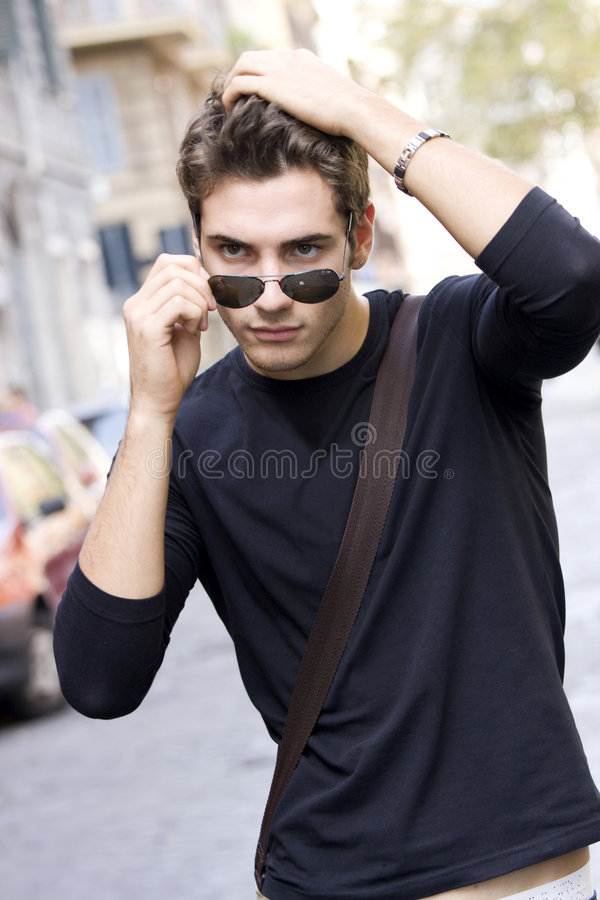 Cool fashion model man plain t-shirt sunglasses stock image