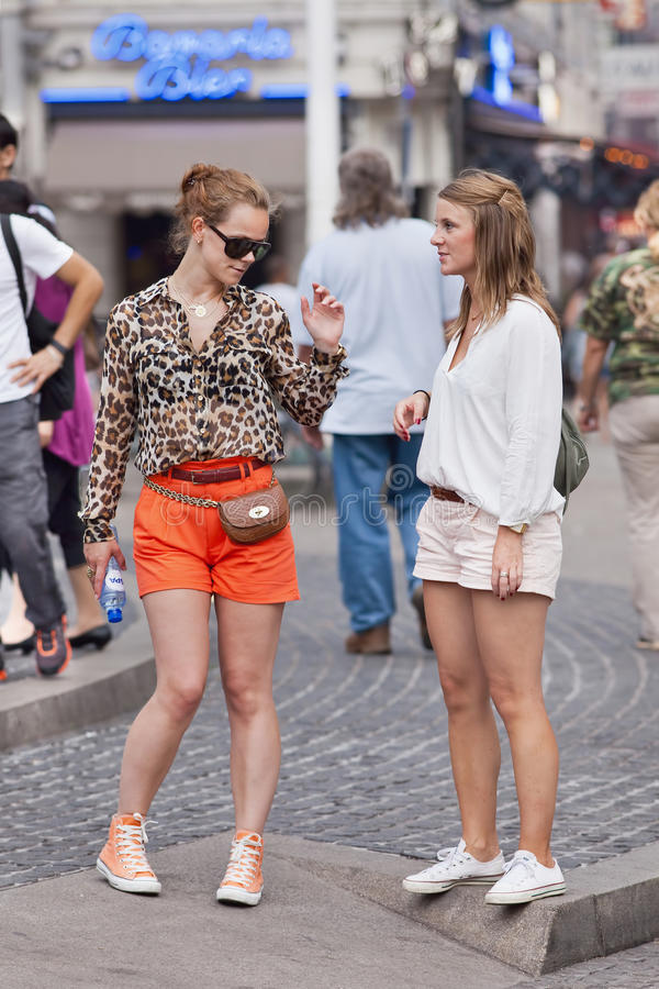 Cool fashionable girls on the Dam Square, Amsterdam, Netherlands royalty free stock photography