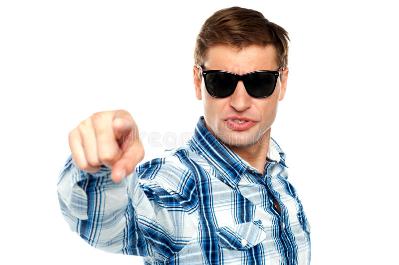 Cool fashionable guy pointing at you. Wearing sunglasses stock photography