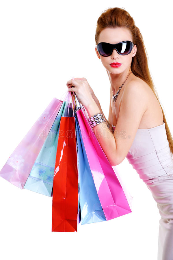 Cool female with shopping bags after shoppings royalty free stock photography