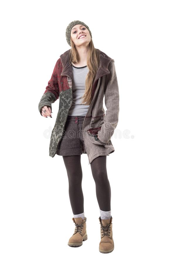 Cool funky candid young hipster girl in stylish warm winter season clothes put something in handbag stock image