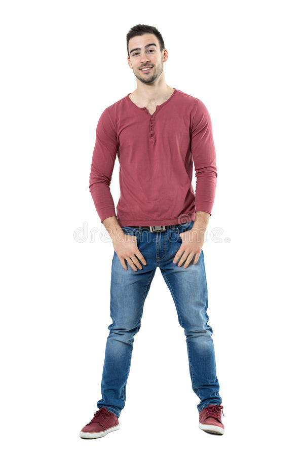 Cool funny stylish smiling casual man with raised eyebrows looking at camera royalty free stock image
