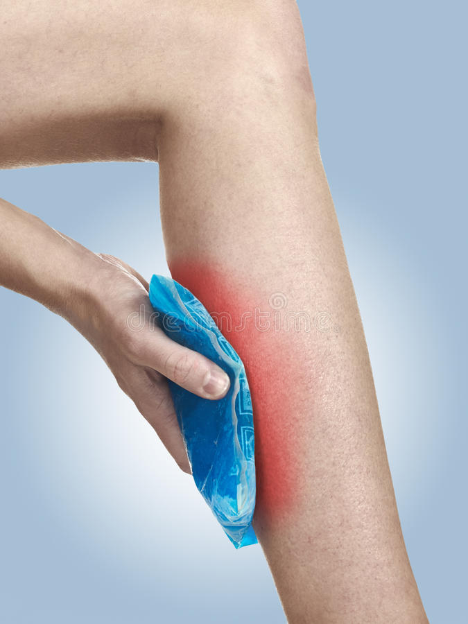Cool Gel Pack On A Swollen Hurting Calf. Royalty Free Stock Photo