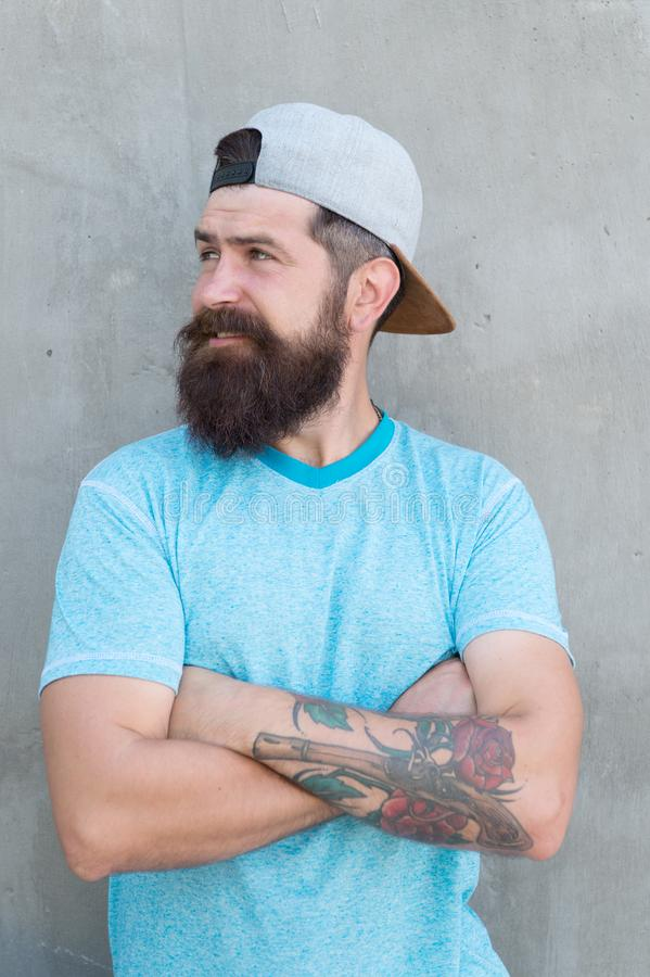 Cool hipster with beard wear stylish cap. Barber salon and facial hair care. Hipster lifestyle. Brutal handsome mature stock photos