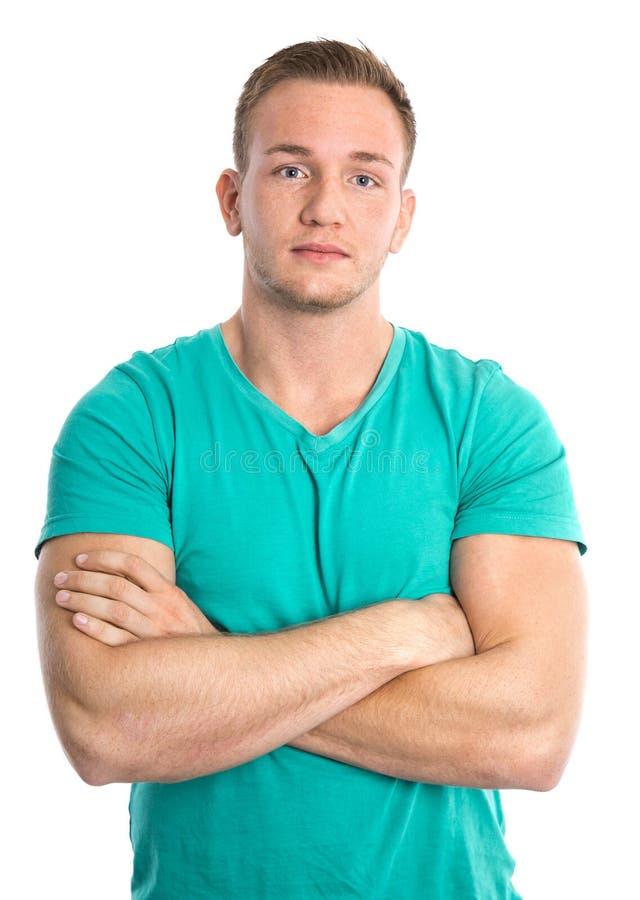 Cool isolerade den unga sportive blonda mannen i grön skjorta royaltyfri bild