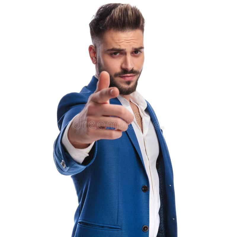 Cool man in suit pointing his finger to camera. On white background royalty free stock image