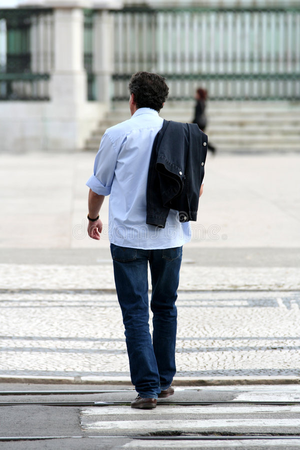 Cool man walking in the street royalty free stock images