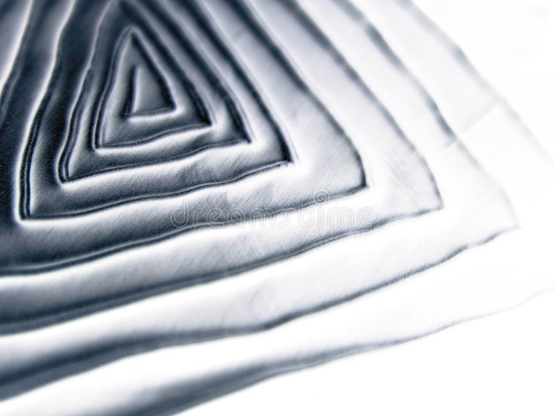 Cool Metallic Spiral Texture. A spiral metallic texture pattern with the appearance of a triangle shaped maze. Ideal as a background, layer or texture royalty free stock photography