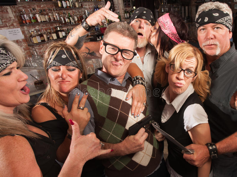 Cool Nerds with Biker Gang. Nerd husband and wife being cool with biker gang in bar stock photography