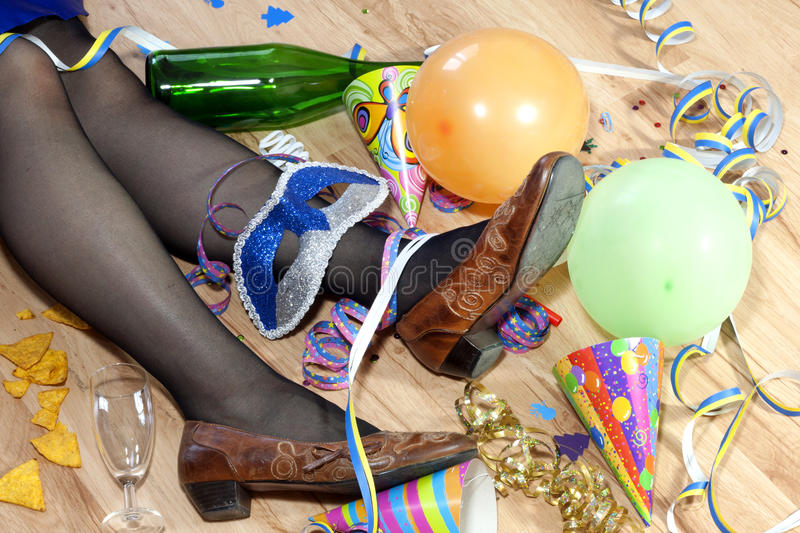 Cool party. Messy room after cool party next day and sleeping drunk woman stock photo
