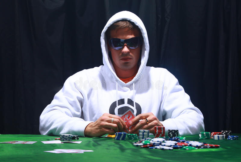 Cool poker player. On dark background royalty free stock photo