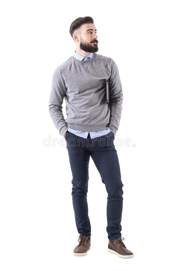 Cool relaxed modern millennial guy with notebook standing and looking away. Full body length portrait isolated on white studio background stock photos