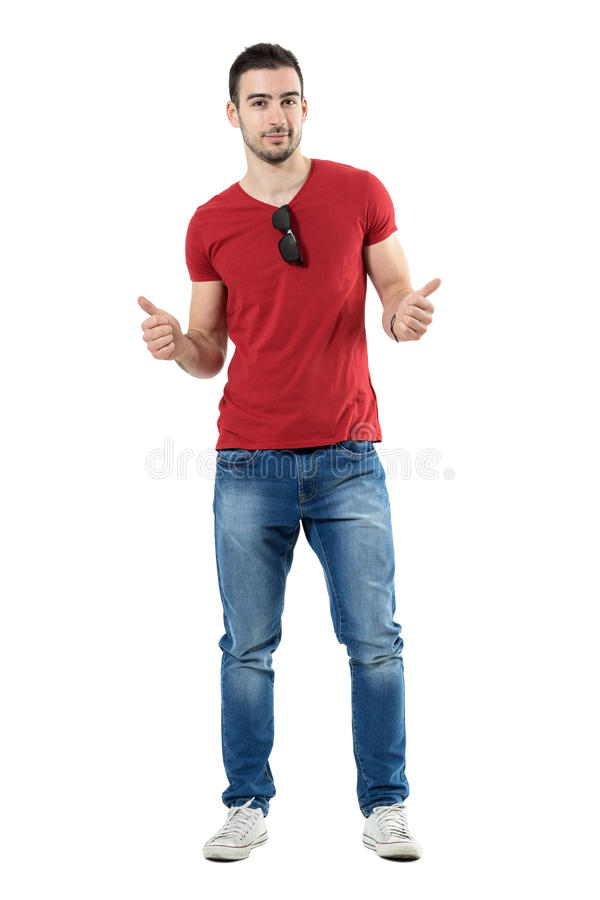 Cool relaxed trendy casual man with thumbs up gesture looking at camera. royalty free stock photos
