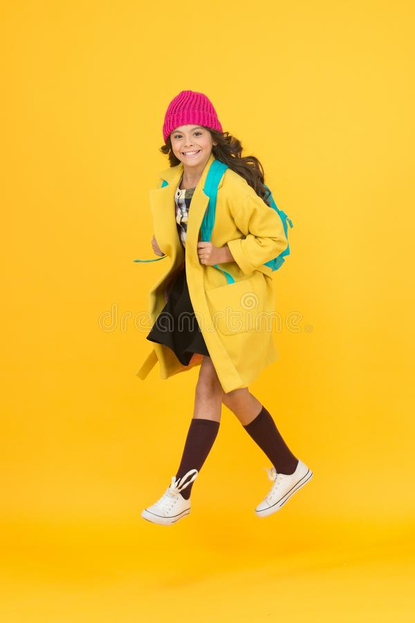 Cool schoolgirl. Have fun charismatic girl on yellow background. Madcap concept. Teen age. Girl adorable stylish modern royalty free stock image