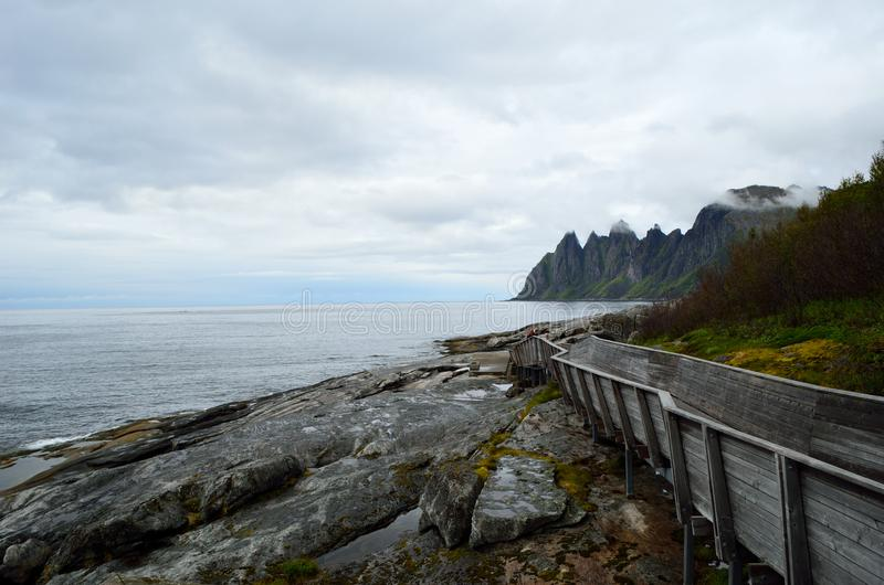 Cool shaped wooden bridge leading down to the view point to see the Okshornan mountain stock photo