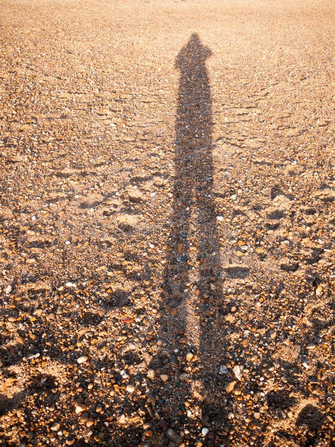 Cool silhouette reflection shadow shade in sand beach cobble tex stock photography