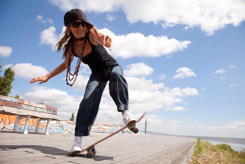 Cool skateboard woman. At a public graffiti park royalty free stock photos