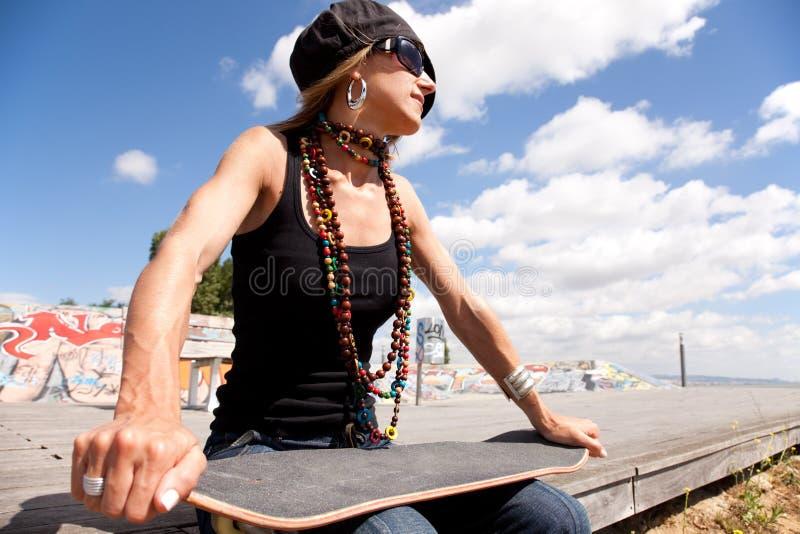 Cool skateboard woman. At a public graffiti park royalty free stock images