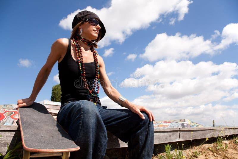 Cool skateboard woman. At a public graffiti park stock photo