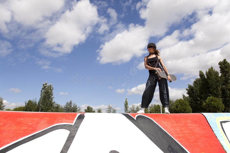 Cool skateboard woman stock image