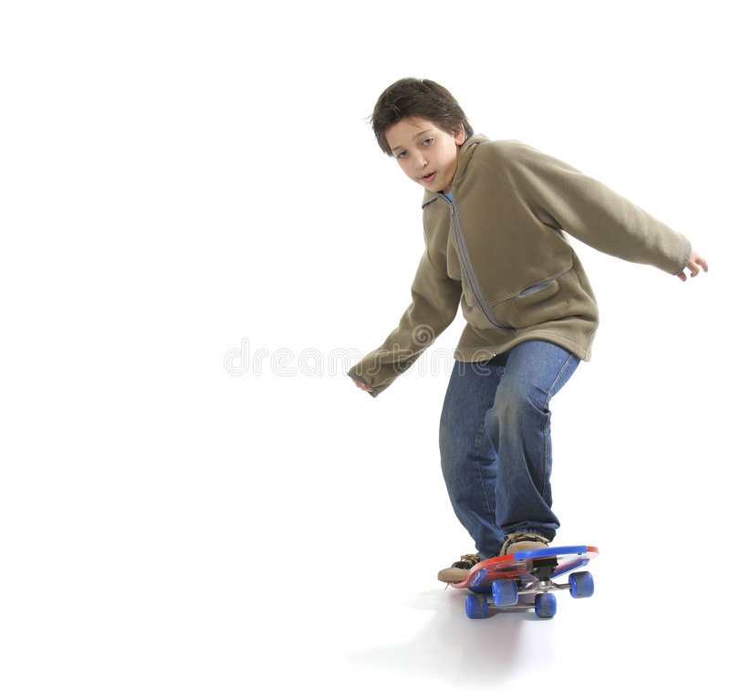 Cool skater boy. Cool boy skateboarding. Full boy, white background. More pictures of this model at my gallery royalty free stock image