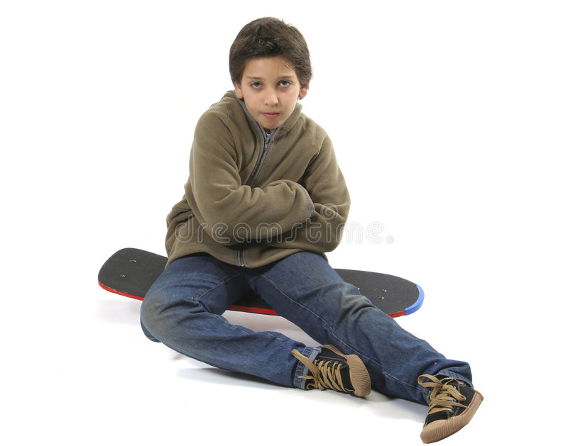 Cool skater boy. Cool boy sitting on a skate. Full body, white background. More pictures of this model at my gallery royalty free stock image