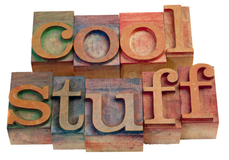 Cool stuff. Words in vintage, wooden letterpress printing blocks isolated on white stock image