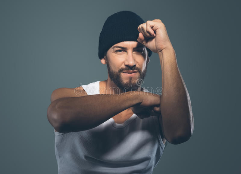 Cool stylish rapper gesturing. And smiling at camera royalty free stock image