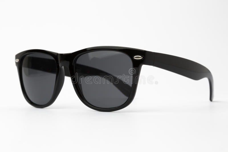 Cool sunglasses with black plastic frame isolated on white background, top view. royalty free stock photo