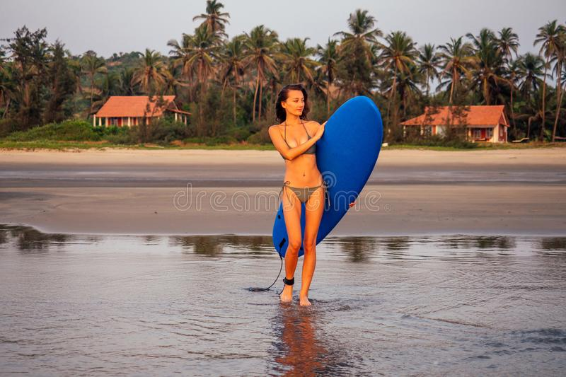 Cool surfer girl perfect fit body in teaching and practicing surfing class.young and beautiful woman in bikini swimsuit royalty free stock photography