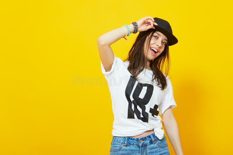 Cool teenage girl in hip hop outfit royalty free stock photo