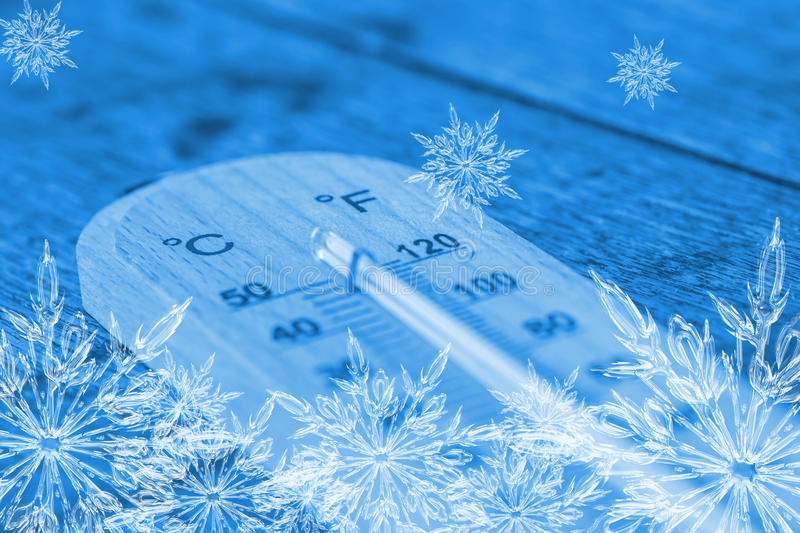 Cool thermometer with ice flake. stock photography