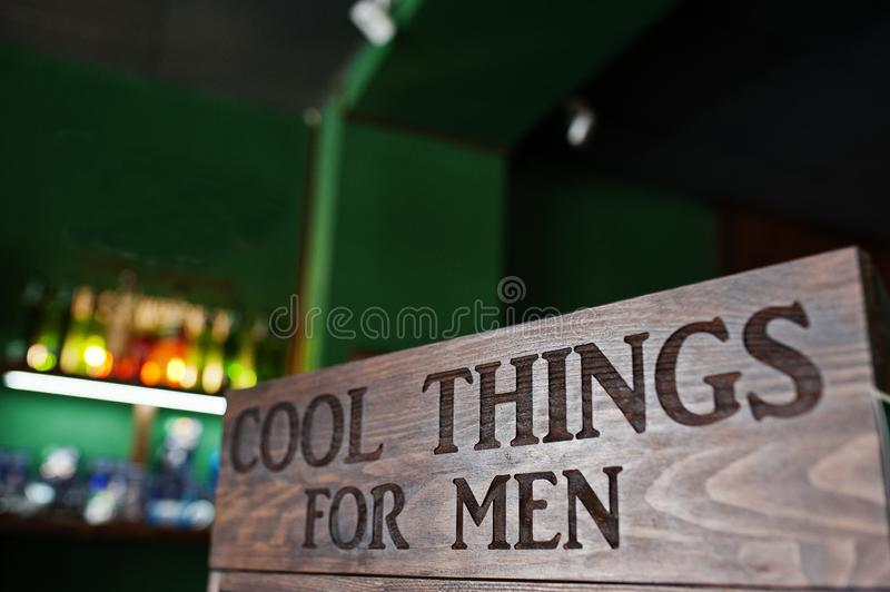 Cool things for men, sign on wood at barbershop.  stock photos