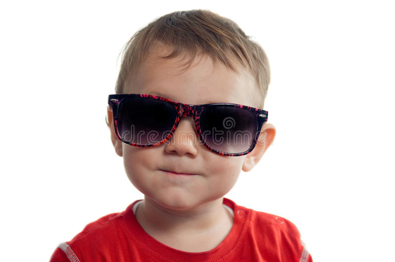 Cool toddler wearing sunglasses stock photo