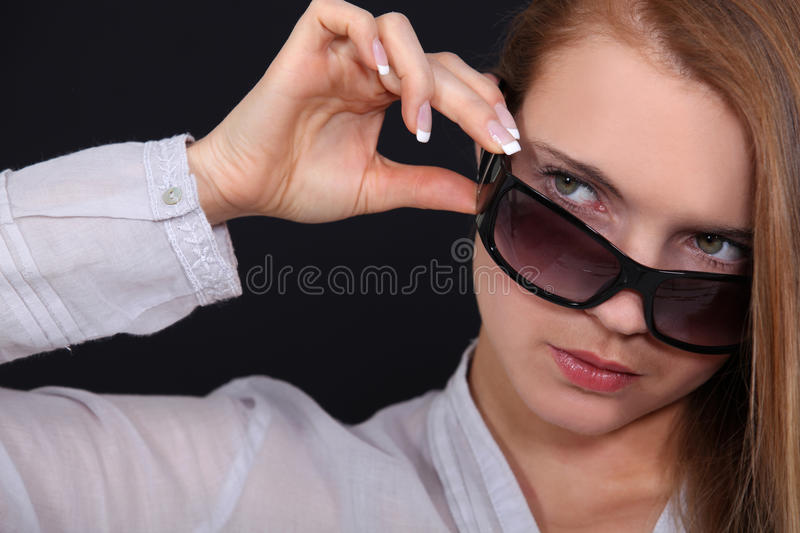 Cool woman in sunglasses royalty free stock photos