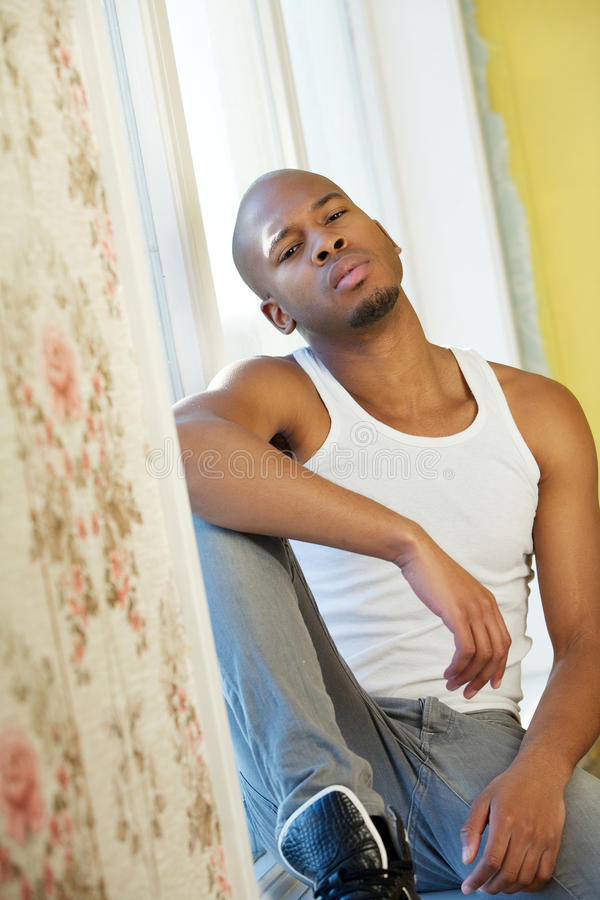Cool young black guy relaxing at home. Portrait of a cool young black guy relaxing at home stock photos