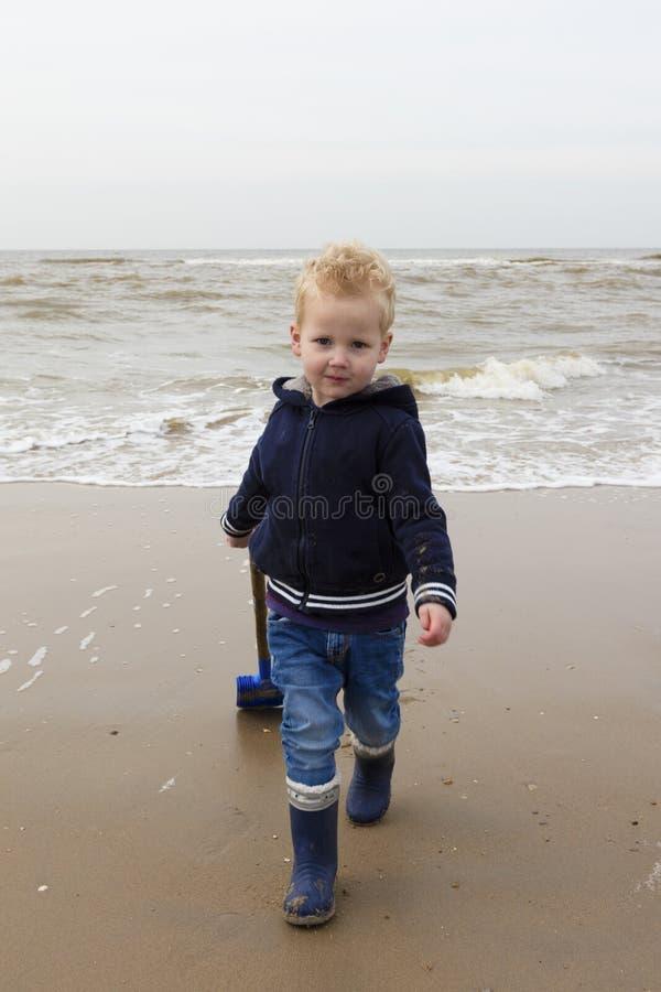Cool Young Boy Playing At North Sea Coast royalty free stock photography