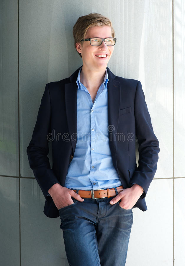 Cool young businessman smiling outdoors stock photo