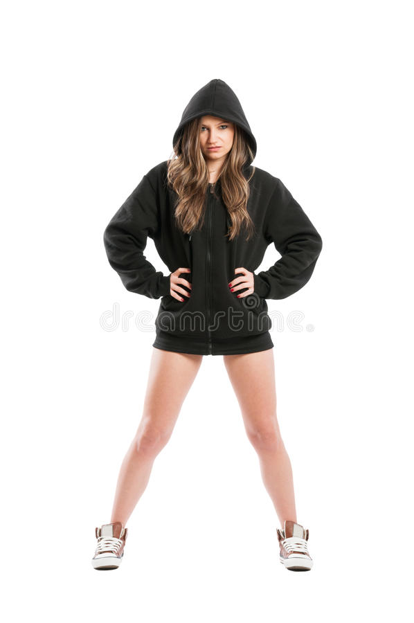 Cool young female model wearing a black hoodie. Cool and young female model wearing a black hoodie on white background stock photography