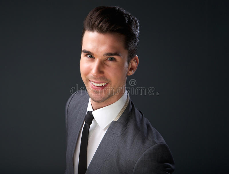 Cool young guy smiling in business suit and necktie royalty free stock image