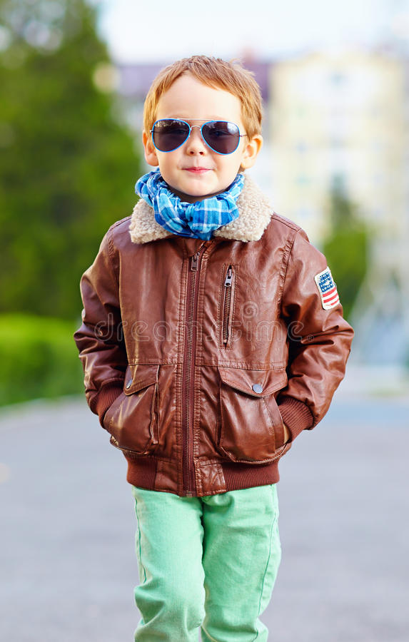 Cool young kid walking the street royalty free stock photography